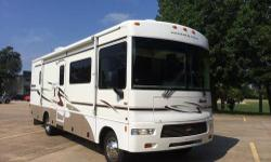 """2006 Winnebago Sightseer """"29R"""" Special Edition with 26,500 miles. Ford Triton V10 with the Automatic Transmission, plenty of power and a proven set up. It features two slide outs, one in the living room/kitchen and one in the bedroom. It has a queen size"""