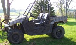 2006 Yamaha Rhino UTV camo pattern, with performace chip and Mudzilla tires in great shape.