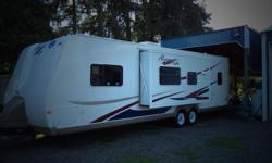 31ft travel trailer one slide out sleeps 8 can tow with half ton pickup go camping or live in trailer. 9,995obo please call or text 503-510-4615