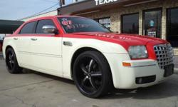 """Miles: 125,229 Year: 2007 Make: Chrysler Model: 300 Touring Title: Clean CAR FAX Guaranteed! Features: Leather heated seats, cruise control, power windows, power locks, power seat, fog lights, Kenwood radio, sun/moon roof, 22"""" Boss aftermarket rims,"""