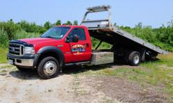 2007 Ford F550, XLT Super Duty, automatic, 6 liter Power Stroke Turbo Diesel V8, vehicle hauler Flat Bed - WITH 4WD. Equipped with air conditioning, cruise control, keyless entry, AM/FM/CD radio/player and heated side view mirrors. This truck has 156,900