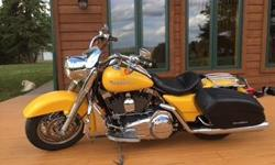 2007 Road King Custom. 13,400 adult driven miles. 1 owner. Crome Controls Kurakyn grips Highway pegs Mustang seat with matching passenger seat with sissy bar Quick change luggage rack New Rear tire Serviced with synthetic fluids Ready to go. Call