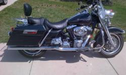 Beautiful 2007 HD Road King with under 10K miles. Awesome list of extras: Passenger backrest, billet wide band grips, mini-mach on the handle bars, headlamp and passing lamp skull covers, skull gas cap, tank bra, brake & turn signal module, wide