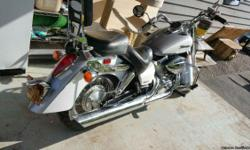 Beloved Honda Shadow Aero. Always covered and maintained. Tune up, new battery, new tail lights, and low miles. The color is silver and pearl. Runs like a new bike. Extras include saddlebags, cruise control, and attachment for windshield. Has always done