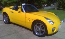Yellow five speed manual trans, A/C, Leather, CD Player, XM Radio, New rims and tires, ABS, power steering.