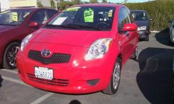 This daring red Toyota Yaris has hardly been driven - only 16,000 miles! Toyota powertrain warranty is still with the vehicle! Gas mileage in the mid-30's on the highway! Front and back seats, hatch back, stereo, A/C, 5-speed manual, and did I mention it