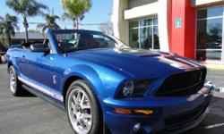 We have one! A big beautiful blue Ford Shelby Cobra GT! extremely low miles, v8 5.4L + supercharger, 6-speed manual with overdrive, leather, power seats, convertible, two-door, spoiler, alloys, cruise control, power windows, power locks, cd changer,...