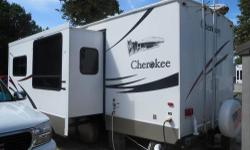 STUNNING 2008 Cherokee by Forest River 27Q- Beautiful 27 foot travel trailer. One bedroom with queen size bed. Night stands, ceiling fan, closets and storage in the bedroom. Slide out Living Room with entertainment center, built in stereo w/ sub woofer.