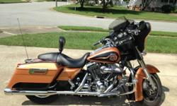 Beautiful ride with 11,600 miles. New rear tire, Custom exhaust and Screaming Eagle Intake, Anti-theft security system that requires the key to be within 8 feet of the bike for it to start,  Air cooled, AM/FM/CD, Side compartments, Cruise control,