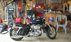 2008 Harley Davidson Sportster 883. Looks like new only has 3200 miles . it has saddle bags on it .