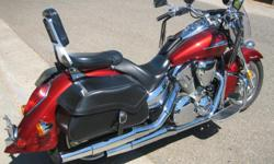 Original owner and bike has low mileage, 8,100. I have 2 helmets his and hers with new face shields clear & tinted. Crome foot pegs, titanium cain lock for rims, battery charger, Ipod speakers installed on bike with amp sound great. All included in