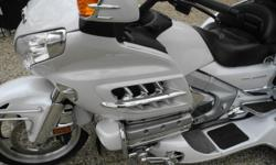 Bike is in like new condition in pearl white color with GPS, heated grips and seat, cruise control, reverse. Motor Trike kit with the motor trike suspension, ezsteer , nice, wide, comfortable running boards. It comes with full cover and