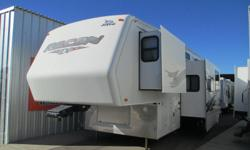 One-Owner Very Nice RV.......TRIPLE Slide-Outs !!! Wide Body Too- Very Roomy Loft 12 Ft. Garage 5.5 Onan Marquis Generator Mor-ryde Hitch- Smooth Ride. 50 Amp Service Two Ducted Roof Airs 2 Large Flat Screens, DVD Player Power Awning Surround Hi-Fi Stereo