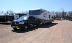 """2008 K-Z Montego Bay 40FT Fifthwheel and 2009 Dodge Dually 3500 combo. High end trailer, original $80,000. Actual length 39' 8"""". 4 slides with awnings. Power awning over entrance door. Heated tanks, enclosed under belly, fully winterized. Fire place, twin"""