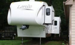 2008 Laredo 300RLS Fifth Wheel Fifth wheel is in great shape and it's never been smoked in. We purchased this unit new and have all the original paperwork. There is some minor damage due to a blowout (see picture) - estimated cost to repair $500-600.