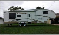 This is a 34ft Fifth Wheel with rear living room and 2 slides. Very Nice! Well taken care of. Great Deal. Must Sell. This is a nice model, it is ranked 12 out of 396 in RVGuide.com The NADA avg price for this model is $21K. We want to make a deal and sell