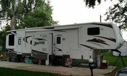 2008 Keystone Raptor 3812. Ready to head to the dunes or can be used as a two bedroom residence. Currently set up as a two bedroom trailer that has more than enough room. Including full size Loft with storage above garage. Loaded with all of the options.