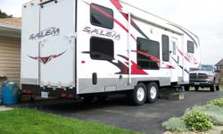 "2008 Salem FL266FLSRV XL Lite Series, 30 ft. 5th Wheel, toy hauler. Pulls great with 1/2 ton truck. Sleeps 10! Has AC, heat, water heater, microwave, refrig/freezer, 3 burner stove/oven, 26"" flat screen swivel TV and antenna, with gaming/cable/mp3 jacks,"