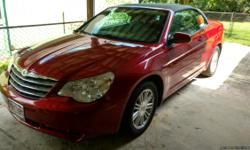2008 Chrysler Sebring Convertible 85,000 miles very clean Red with Black Top. Runs good