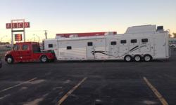 39 foot, trailer with a 20 ft short wall. Tricked out living quarters. Seperate sleeping areas with a king bed and bunk beds. It also has a sofa bed in the main room. 3 tvs 3 dvd players, satelite, 2 water tanks, plenty of closet