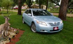 Stunning Ice Blue Pearl Metallic! Light gray leather interior. Clean title in hand, never in an accident, no dings! 67000 miles. Drives and looks new! Power everything! Rear spoiler, body side molding, too many features to list! 4 cyl. Great gas milage!