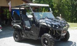 2008 Special Edition Yamaha Rhino 700 4x4 ( for $2900 ) that has been custom built to accommodate family cruises in a safe and secure way. With only 900 miles this Rhino has no scratches. scrapes, bends, or breaks. It is in most excellent condition. for