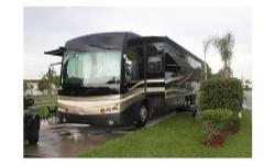 2009 American Coach American Allegiance 42g , BEAUTIFUL, spacious coach with so many features. To mention a few...4 TVs, leather sofas w/queen pull out bed, 3 slide outs include 1 full-length super slider, 3 window awnings, triple slide toppers, Cummins