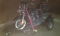 Softail with only 6800 miles. Two new tires with whitewalls. Removable windshield. Leather saddlebags, lots of chrome. Trailer is also available. In perfect running condition.