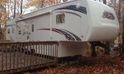 2009 K-Z Sportsman 3SP Sportster 35ft Fifthwheel. Sleeps up to 12 people. 3/4 ton towable. Only towed for 6000 km. Been on a seasonal site since 2010. Loaded with option. 5.5 Onan generator with 3 hrs on it, fuel station 100L tank, 8x10 garage with 2 fold