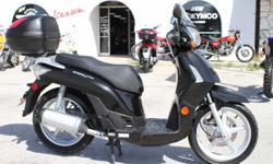 2009 Kymco People s200 Black, Low miles, very clean, great gas, givi top box 1995.00  The Motorcycle Shop 2423 Austin Hwy San Antonio, TX 78218 210 654-0211  Come in and check it out!