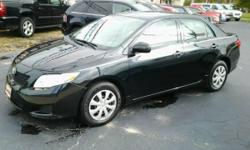 Black exterior, tan cloth interior on this 2009 Toyota Corolla!! What a gem! Under 67k miles and sporting a clean carfax report - in addition to the clean interior and exterior! AM/FM/CD, cruise, a/c, power windows & locks. Good rubber on the tires! Great