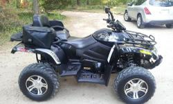 For sale is my lightly and gently used Metallic Black 2010 Arctic Cat TRV 700i with GT wheels. I am the original owner. It's in EXCELLENT to Like New condition cosmetically and mechanically. No issues at all! It would be hard to find one in nicer