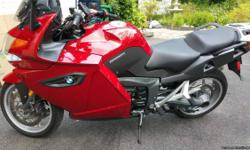 2010 BMW K 1300 GT, 2010 BMW K1300GT Premium in Red Apple Metallic 15,700 miles. This ultimate sport tourer is shaft driven and propelled by a 160HP in-line 4 cylinder motor producing 99ft-lbs of torque. It is a premium model which includes