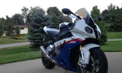 2010 BMW S1000RR Motorsports Paint 6,xxx miles Painted lowers to match blue on uppers Painted front fender Alpine White -1 +2 520 conversion Lightech chain adjusting system Bridgestone S20's with 500 miles on them Double Bubble windscreen Greggs Customs