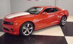 """Stk#019 2010 Chevy Camaro SS Exterior: Inferno Orange metallic factory paint. Dual exhaust, Borla rear spoiler, 20"""" painted aluminum rims, Intermittent windshield wipers, heated power outside rear view mirrors with drivers auto dimming, Halogen head"""