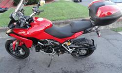Red Ducati Mulstistrada 1200 with ABS. Excellent condition. Comes with top box and panniers and Full Termignoni exhaust.  Please ask me whatever you need about the bike:trentonkeller67@outlook.com