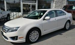 2010 Ford Fusion Hybrid Sedan!! Navigation; Moonroof; Rear View Camera; Blind Spot Monitoring System; Full Power; 17 Alloy Wheels; Heated Seats; Dual Climate Control; Traction Control; Sync; 'Sony' Sound; and Keyless Entry!! All of our inventory is