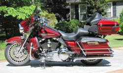 2010 Ultra Classic Electra Glide with 5,174 miles. It is FUEL INJECTED with a SIX SPEED TRANSMISSION, and comes in optional solid Red Hot Sunglo paint. The condition of this beauty is exactly what you would expect for a well cared for 2010? excellent. Pay