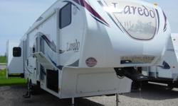 Like new-2010 Keystone Laredo 321 Bunkhouse. Loaded with every feature available-full bathroom with oversized glass shower, toilet area, and sink located in front bunk area. Half bath located in rear area master bedroom. Full kitchen with stove, cooktop,