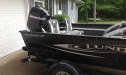 """2010 17' 10"""" Lund Predator SS No more than 40 hours on this boat! Stored winters. Mercury 75 horse 4 stoke motor Terrova Minn Kota trolling motor Live well Cover, trailer, spare tire. Excellent condition!"""
