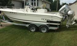 Original Owner I've got an R-200 21' Robalo Center Console with T-Top. This setup has a 200 HP 4-Stroke Honda Motor with 400 hours on it, along with an 8 HP 4-Stroke Honda kicker with Troll Master Control. It has an HDS-8 Lorance Graph and GPS. Along with