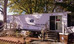 One-owner, non-smoking in excellent condition. Sleeps 4...Queen-size bed and Queen-size air-bed sofa in LR. Has regular size refrigerator, gas stove and lots of Oak cabinet space. Hardwood & carpet in living room and carpet in bedroom. Has 2 slide-outs,