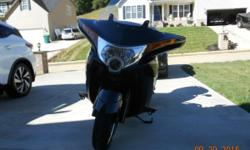 2010 Victory Vision 8-Ball, it only has 11,994 miles. I just replace the rear tire. All services have been done at authorized Victory Dealerships. ACCESSORIES and EXTRAS INCLUDED with BIKE !  Exhaust Upgrade  Garmin