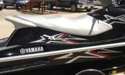 Black & Silver 2010 YAMAHA VX110 DELUXE, 11O HORSEPOWER FUEL INJECTED FOUR STROKE, THREE SEATER WITH REVERSE. Ski has always been garaged, washed and flushed with special cleaner after each use. 55/hours. . Zeiman Galvanized trailer included. regular