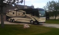 2011 Damon Tuscany 42RQ, 18,500 miles, 360 H.P. Cummins w/6spd. Allison Transmission, Freightliner Chassis, Tag axle, full body paint, Fog and Docking Lights,Roof Ladder, full pass-thru basement w/sliding drawers, 4 slide-outs w/awnings, pwr. main awning,