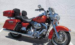Immaculate 2011 Harley Davidson FLHR Road King. This Stunning Motorcycle has only 6717 miles on it. This is one Super Clean Beautiful Sedona Orange Metalic Road King. This bike has a Smooth running 96 cubic inch engine and smooth shifting 6-Speed