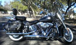 ?KING OF THE CRUISERS? 2011 Harley Davidson Heritage Softail Classic Low-mileage ? 10K. Single-owner. 100% Stock. Classic black & merlot. Matching studded leather seat & saddlebags. New whitewall tires. 96 cu inch engine. Six-speed. ABS. Security system.