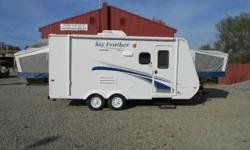 2011 Jayco Jay Feather Sport, Light Weight Camper, Can be towed with a small SUV or Truck, 20 foot lone and only 3250 lbs dry weight, Sleeps 8, Roof AC, Awning, Self-contained, and much more! NADA Book Value is $13,800 See many more photos on our