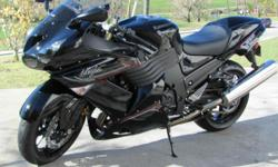 2011 Kawasaki Ninja ZX 1400! There is not one scratch on this motorcycle!! It stays in my garage!! It has just over 1000 miles on it!! It comes with 2 matching black helmets!