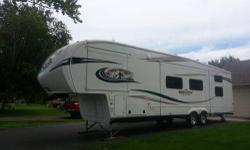 """Almost new 5th wheel with four slides. Brought brand new but don't have the time to use it as much as we would like to. This camper has only been used a handful of times and still has the """"new"""" smell. Equipped with the Woodland decor package, Hickory"""